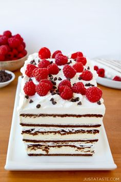 Easy Ice Cream Sandwich Cake  recipe from justataste.com | Store-bought ice cream sandwiches layered with whipped cream and fresh raspberries. #recipe #summer @justataste