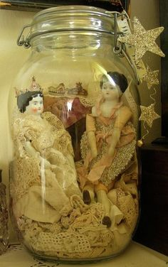 An old jar! Why not display some Victorian German china head dolls inside. Add some lace and you have a beautiful vignette!
