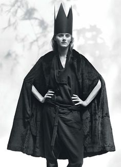 Ann Demeulemeester's black weasel fur and leather cape and black wool, linen, and cotton coat and pants, W Magazine.