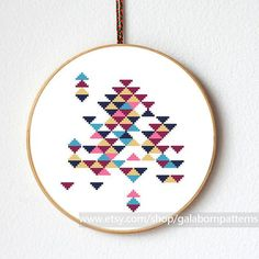 Tittle: Abstract triangles  This PDF counted cross stitch pattern available for instant download.    Skill level: Beginner.    Floss: DMC