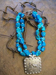 Large turquoise chunk necklace with praying cowboy concho pendant. $45