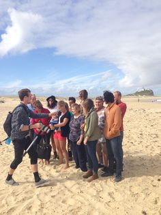Setting up the photoshoot for our new website banner! We love multi-generations. And family. And the beach. II Youth With A Mission II YWAM Newcastle  www.ywamnewcastle.com