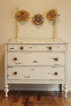 Vintage Distressed Dresser with vintage flower decorations
