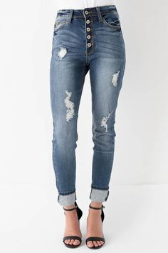 """Our As High As The Tide Skinny Jeans features a high rise medium washed denim bodice, distressing down the pant legs, 5 pocket in styling and 5 white button front enclosures. Unlined. 98% Cotton. 2% Spandex. Machine wash cold, tumble dry low. Size & Fit Fit: this garment fits true to size. Length: Size 3/25 measures 39'' from waist to hem. Rise: 11'' Inseam: 29'' Model Info Height: 5'8"""" Wearing size: 1/24"""