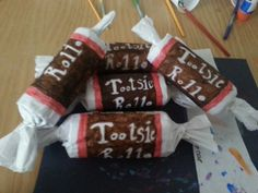 Simple Instructions : Candyland Party decor...Tootsie rolls made out of clean toilet paper rolls, white tissue paper and tape. Decorated with markers..Created by: Amanda M.Thomas 11/16/13
