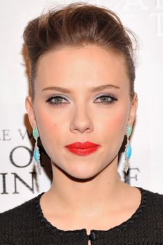 Scarlett Johansson wearing chrysoprase (green) and turquoise (blue) earrngs