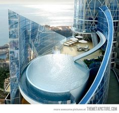 This amazing penthouse comes with its own water slide…