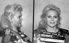 Zsa Zsa Gabor arrested for battery, disobeying a police officer (slapping said police officer), driving without license and registration, and driving with an open container of alcohol, 1989.
