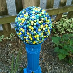 Bowling ball covered in marbles