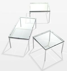 Florence Knoll Coffee and End Tables. Classic low table with clear glass surface-- clean, hard lines but delicate due to transparence.