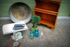 Friday finds. Big metal tub, small wooden hutch, baby scale (I've been looking for one FOREVER), blue jars, topiary, scrabble tiles and old books