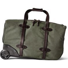 ced4d134b5 Filson is known for their heavy-duty travel bags but the Otter Green Small  Rolling Duffel breaks this mold.