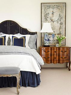 Antiqued elements contrast with a crisp white coverlette in this master bedroom. The worn wood legs on the bench and faded fresco-style art piece add to the country French vibe, as does the luxurious navy velvet that dresses up the bed. French Country Dining Chairs, French Country Living Room, French Country Bedrooms, French Country Style, Country Bathrooms, French Cottage, Bedroom Country, Country Kitchen, French Decor