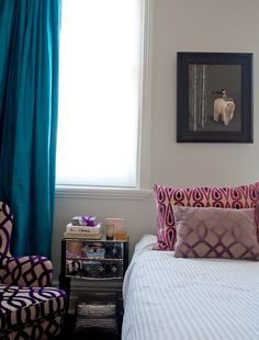 Jewel tone curtain with violet pattern on chair - I never would have thought to put these together - it's wonderful and fun