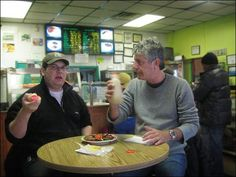 Famous(?) Fat Dave and Anthony Bourdain down some jerk shrimp in the Bronx.