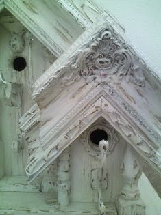 Birdhouse with old frames and other flea market finds - crystals, coat hooks, rubbed paint finish