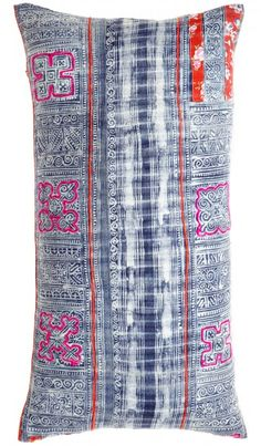 Hand selected from John Robshaw's vintage collection for Calypso, this one-of-a-kind, handmade pillow details a traditional batik printed canvas with embroidered yarn accents and floral fabric patches.