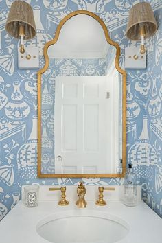 Bathroom Mirror Arched Brass Mirror against blue and white wallpaper and a pair Piper Sconces in Brass by Ro Sham Beaux Bathroom Mirror Gold Geometric Wallpaper, White Wallpaper, Wallpaper Ideas, White Vanity Mirror, Brass Mirror, White Bathroom, Mirror Bathroom, Bathroom Ideas, Basement Bathroom