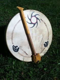 Native American drum. ( Beater is a wooden dowel and the head is poorly made. Very important to have a GOOD beater for your drum. JLynne)