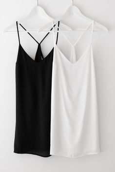 """Simple and casual mini dress with a racerback, spaghetti straps and a V neckline. Made with lightweight and sheer material that is non-stretch. Dress is fully lined. Size small measures approx. 33"""" in length. Available in black or off-white.  100% Polyester Made in USA"""