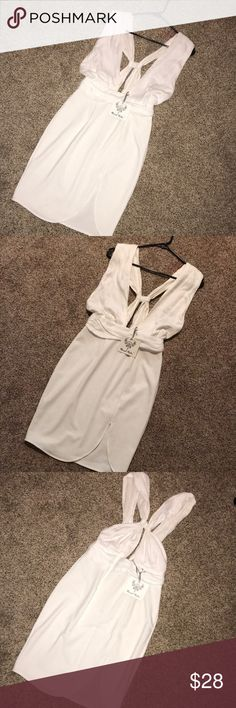 Brand new never worn white dress This is a brand new medium white dress from Mura boutique. It's never been worn and still has tags. It can also be worn in different ways with the straps crossing in the back and or in the front. I looks good either way and was modeled with it crossing in the front when I bought the dress online! Perfect for summer!! PLEASE feel free to make an offer :) Mura boutique Dresses Mini