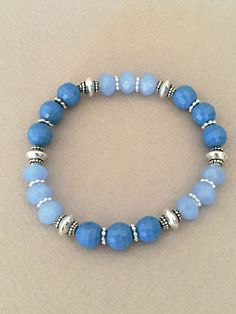 A personal favorite from my Etsy shop https://www.etsy.com/listing/449324260/blue-crystal-dangle-bracelet-blue-beaded