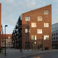 Image result for steep pitched roof apartment building architecture