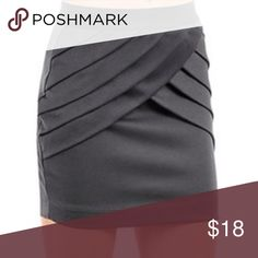 NYMPHE Charcoal Gray Pleated Mini Skirt Take on the night in this NYMPHE Charcoal Gray Pleated Mini Skirt! Whether its date night, girls night out, or a special event in the summer, this skirt has you covered. Pair it with black tights in the winter. All over charcoal gray fabric is topped with a beautiful pleated detail in the front. Black elastic banded waist fits comfortable to each body. Slip on style. Material is easy to dress up. 95% polyester 5% spandex. NEW WITH TAGS! Size SM. I'm a…