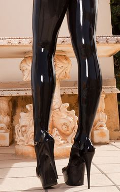 long, long legs in tight, shiny black latex