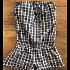 Cute Strapless Romper This very cute, strapless romper is great for spring and summer.  Plaid print with metallic thread throughout.  Decorative beaded tie at bust. Other