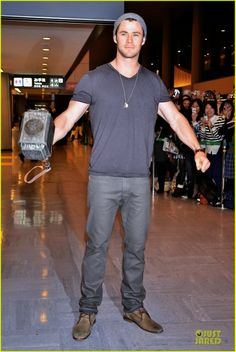 Celeb Diary: Chris Hemsworth shows off his Thor hammer while arriving on a flight at Narita International Airport in Tokyo, Japan