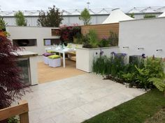 Jura Grey Limestone paving has tiny fossils flowing throughout its cool coloured surface, as seen here in Creative Roots award winning garden design.