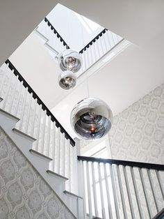 @Sarah Chintomby Chintomby Blakely Mirror Ball Tom Dixon pendants in your staircase!