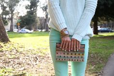 clutch and colored jeans