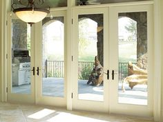 Patio French doors with built in blinds are major breakthrough designs for patio doors. The built in blinds on patio French doors make the doors look modern and the house look futuristic in general. Double French Doors, French Doors Patio, French Patio, Craftsman Patio Doors, Bungalow Exterior, Craftsman Homes, Transom Windows, Windows And Doors, Ceiling Windows