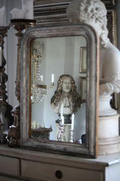 a fine old worn French Louis Phillipe silver mirror