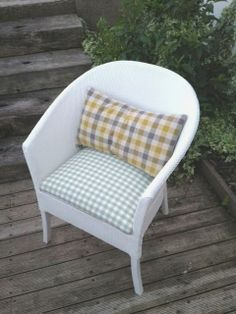 A beautifully resored Lloyd Loom Chair made by my daughter Holly, using Laura Ashley gingham. 2013.