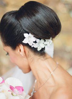 Photography: Ken Tan - kentanphoto.com  View entire slideshow: 15 Best Bridal Buns on http://www.stylemepretty.com/collection/539/