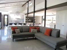 Living Room Living Room with Grey Sofa for Elegant Look in Style Astonishing Gray Sectional Sofa At Mid Century Living Room Design With Grey Sofa And Orange Pillows And Granite Tile Floor
