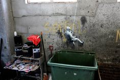 Wall climber going down to garbage bin. By #Strok #streetart