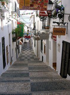 Passageway with restaurants and shops in Altea, Spain.