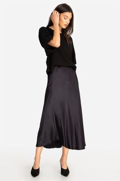 Our Crinkle Satin Asymmetric Skirt is the skirt of dreams. Immerse yourself in silky smooth sophistication with this full-length skirt. The asymmetric cut gives a fun and feminine look that is perfect for everyday wear, like grabbing coffee, or for your n Full Length Skirts, Asymmetrical Skirt, Johnny Was, Midi Skirt, Feminine, Legs, Pants, How To Wear, Black