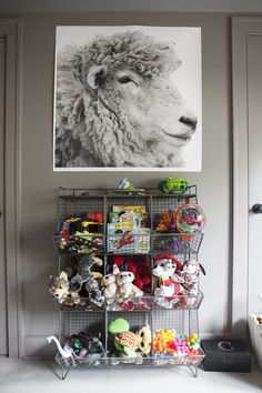 This Charlotte home was designed with kids in mind. Here, wire cubbies control the clutter.