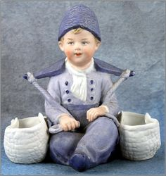 German  Heubach All-bisque Seated Dutch Boy Figurine, c.1910