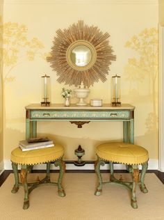 love the yellow and seafoam green color scheme and contrast of soft curves with the sunburst mirror