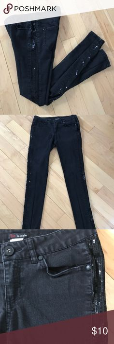 Black skinny jeans with sequins on the sides Black lately faded distressed skinny jeans with sequins on each side of the leg pants Jeans Skinny