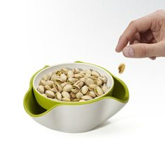 Double Dish from JosephJoseph has larger lower bowl to collect shells from finger snack foods.