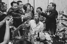 A documentary photograph of wedding guest toasting the bride and groom during a vietnamese wedding in Boston Massachusetts Gina Brocker Photography