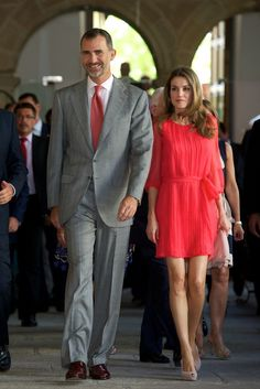 Nothing says summer like a bright dress and Princess Letizia chose the perfect, watermelon-colored, pleated frock to wear during a July trip to theInstituto Cervantes directors meeting at the San Francisco in Caceres, Spain.