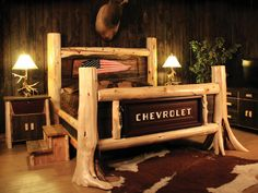 Cedar log bed with Chevrolet tailgate. Chalet Chic, Picture Headboard, Cave Bar, Design Garage, Car Furniture, Automotive Furniture, Upcycled Furniture, System Furniture, Western Furniture